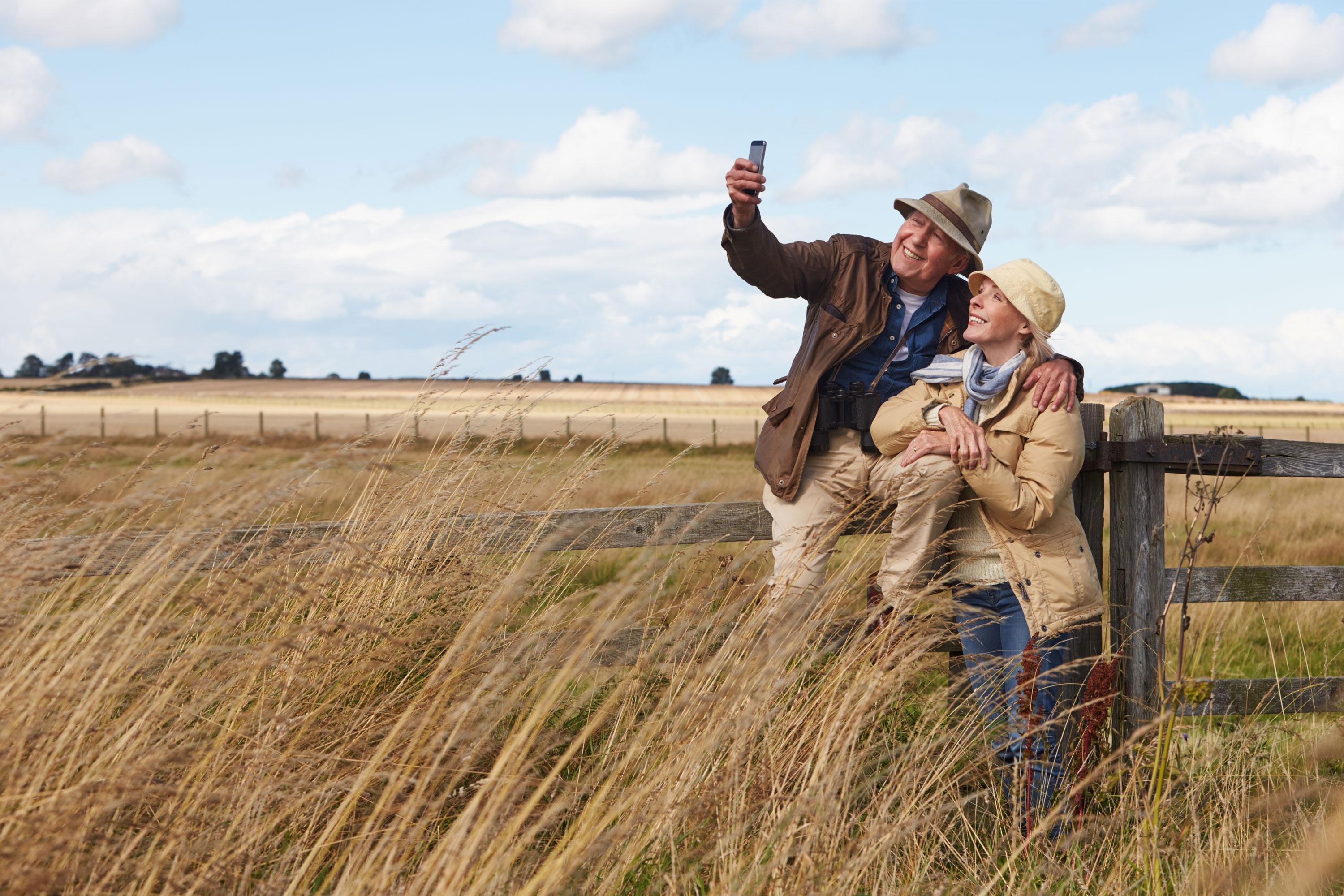 Couple taking a picture in a field